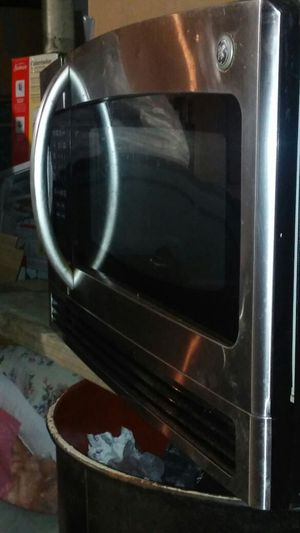 GE over head microwave stain n steel for Sale in Boston, MA