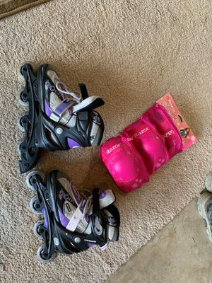 Girls Rollerblades and pads for Sale in Fuquay-Varina, NC