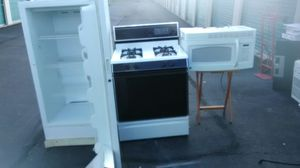 Kitchen combo bundle gas self-cleaning stove full size up right freezer, 1000 watt microwave excellent working condition delivery is possible for Sale in Philadelphia, PA