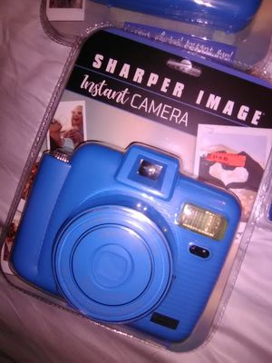 Sharper image camera with two boxes of new film for Sale in Woodstock, GA