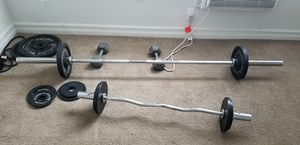 Some weights plus Olympic Bar and 25 lb dumbbells for Sale in Pontiac, MI