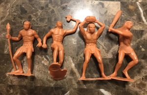 Lot of 4 1963 Vintage plastic Caveman figures features one with a club, one with a rock, one with a seat, and one with a axe by Louis Marx Co. Inc. O for Sale in Carpentersville, IL
