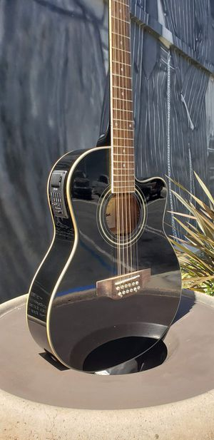 New Black 12 String Requinto Guitar Combo with Gig Bag and accessories. Guitarra Requinto Negro Cutaway con accesorios y Bolsa. for Sale in Downey, CA