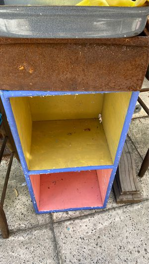 """Small shelf unit with terrible paint Job 29 x 14 x 11"""", put make a great little paper shelf bookshelf. Solid wood. Desperately needs to be sanded and for Sale in West Palm Beach, FL"""