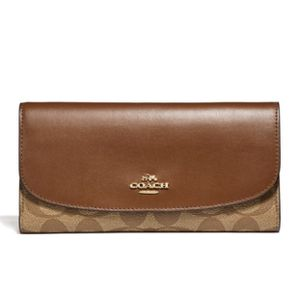 Coach Checkbook Wallet in Signature Canvas for Sale in Las Vegas, NV