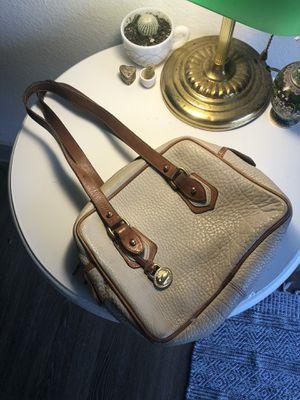 Vintage white Dooney hand bag for Sale in Austin, TX