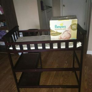 The Pampers newborn premium diapers are sold but the Espresso changing table is still available for Sale in Aurora, CO