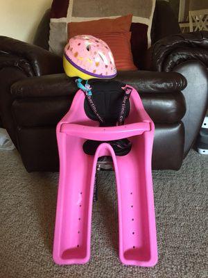 Child's ibert bicycle seat with child's schwinn helmet for Sale in Sebring, FL