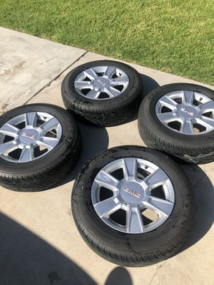 4 Doral 225/65R17 1025 tires with GMC rims for Sale in Riverside, CA