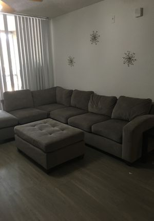 Grey sectional couch for Sale in Tampa, FL