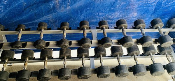 Rubber coated round dumbbells plus rack