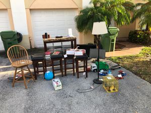Yard Sale items table, jbl speaker, stools, tv, sign, toys, humidor, monitor for Sale in West Palm Beach, FL