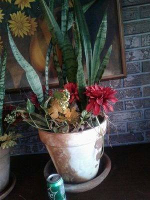 Terra cotta planter pot with mother tongue and fall fake flowers for Sale in Seffner, FL