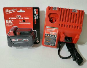 Milwaukee 5.0Ah XC battery 18V+dual battery charger (compatible with 12V/18V Milwaukee batteries) $125.00 is firm price not taking offers!!! for Sale in Lake Worth, FL