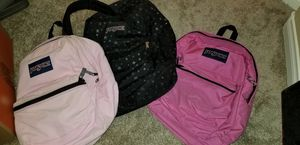 3 barely used Jansport backpacks. L->R, light pink corduroy, black with silver stars, hot pink for Sale in Las Vegas, NV