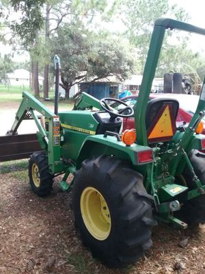 2000 John Deere 4x4 diesel Tractor with front end loader and PTO plus 3 point hitch. for Sale in Sebring, FL