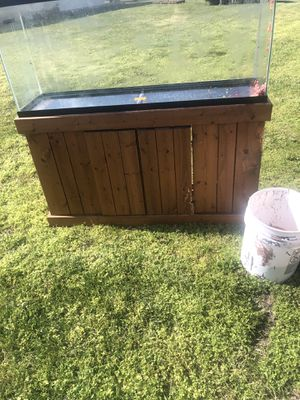 55 gallon fish tank stand and stones used stand needs little repairs for Sale in Pittsville, MD