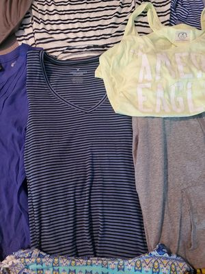 Over 40 womes l/xl shirts. 9 pants size 14, 2 leggings and one shorts size 14. for Sale in Palmetto, GA