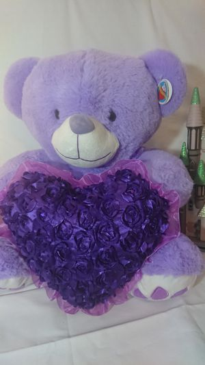 It is a beautiful teddy bear measuring 19 inches tall and 28 inches wide color purple for Sale in Los Angeles, CA