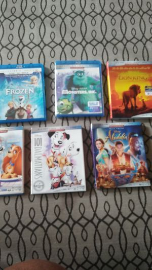 Frozen monsters in The Lion King original Lady and the tramp 101 Dalmatians and Aladdin the original Disney movies for Sale in Cleveland, OH