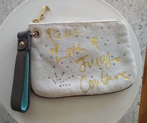Juicy couture wristlet with gold-plated zipper for Sale in Baltimore, MD