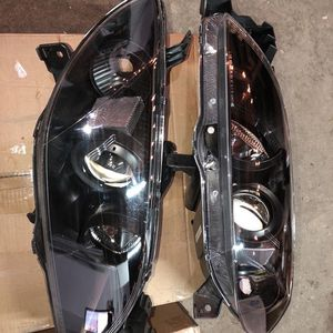 HEADLIGHTS 04-09 Mazda 3 4DR BLACK HOUSING AND CLEAR PROJECTOR for Sale in Los Angeles, CA