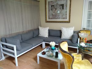 Grey couch, chair and table brand new condition! Paid $1100 for it. can also be used as outdoor furniture OBO for Sale in Las Vegas, NV