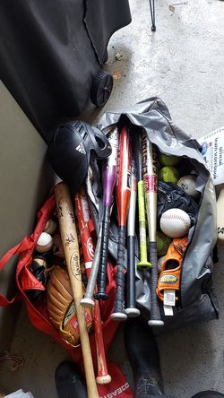 Easton to Louisville bats 4 wood 32s and 6 aluminum 27 inch to 34. Balls and most gloves included also bat bags. for Sale in Portland,  OR