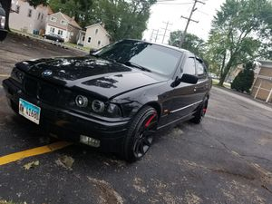 BMW 318i 97 with BMW sports rims for Sale in Aurora, IL