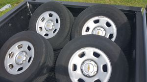 Goodyear wrangler 265/70 R16 tires with rim and caps included for Sale in GRANT VLKRIA, FL