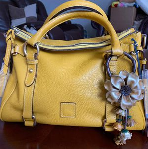 Dooney and Bourke small AWL MUSTARD RETIRED color Dooney and satchel HTW color for Sale in Livonia, MI