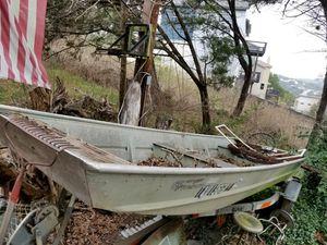 Oachita 15' aluminum flat bottom Jon boat and galvanized trailer for Sale in Austin, TX