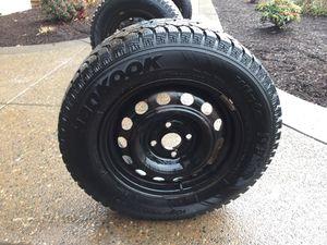 Hankook iPike w409 Winter Studded tires. 185 70 r14 on 4 lug rims. for Sale in Portland, OR
