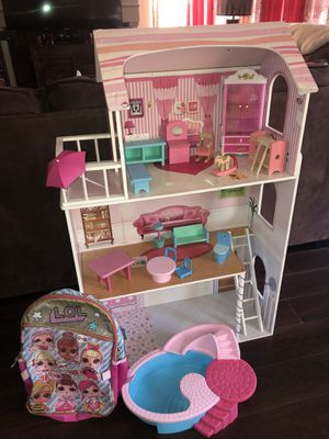 USED Pressed Wood Doll House with Furniture and Barbie Pool BONUS LOL Girls Backpack for Sale in Rancho Cucamonga, CA