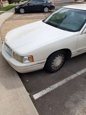 1998 Cadillac Deville runs great only have a 103000 miles on it for Sale in Phoenix, AZ