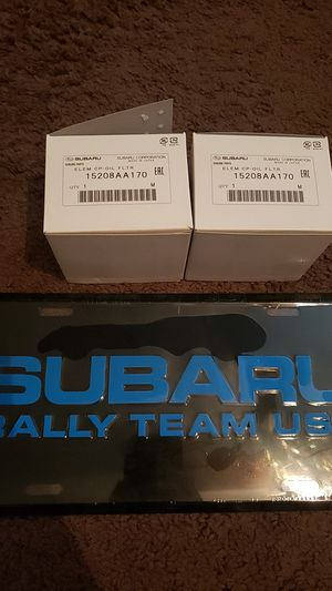 Subaru rally team vanity plate and 2 brand new Subaru oem oil filters part number 15208AA170 for Sale in Pinellas Park, FL