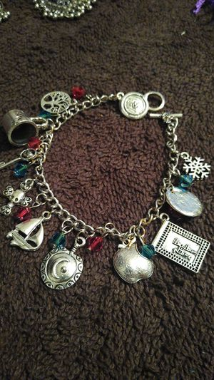 Brand new silver bracelet with charms for Sale in San Antonio, TX
