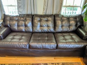 CHOCOLATE FAUX LEATHER COUCH for Sale in Centreville, VA