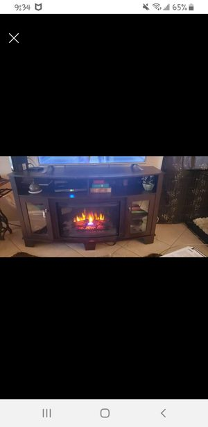 Entertainment Center/TV stand with electric fireplace/heater for Sale in Hudson, FL
