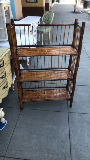 Rattan wicker shelf plant stand 42 by 24 by 9 for Sale in San Diego, CA