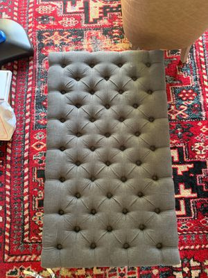 27.5 in by 47 inch length x 19 inch height tufted gray ottoman with wheels for Sale in Danville, CA