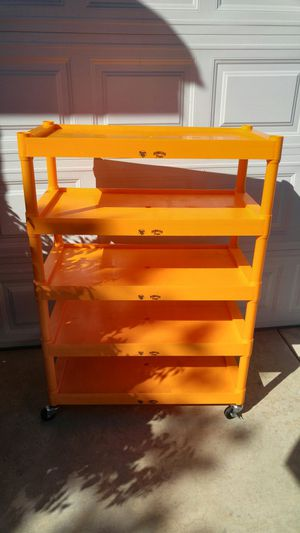 Orange plastic shelf for Sale in Temecula, CA