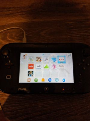 Wii U Console and Gamepad (and cords), +4 games for Sale in Suwanee, GA