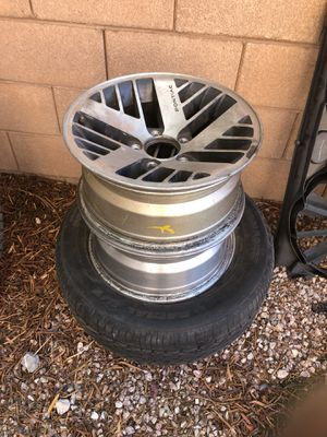 3 pontiac wheels with one tire for Sale in Las Vegas, NV