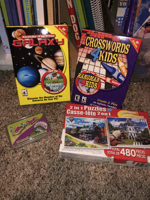 4 toys new sealed only $2.00. Puzzle, games, cards for Sale in Phoenix, AZ