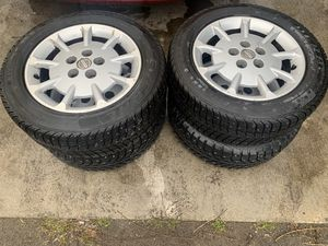 Studded snow tires and rims 215/55R16 for Sale in Kennewick, WA