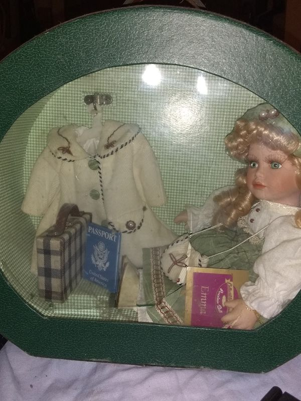 Doll in suitcase