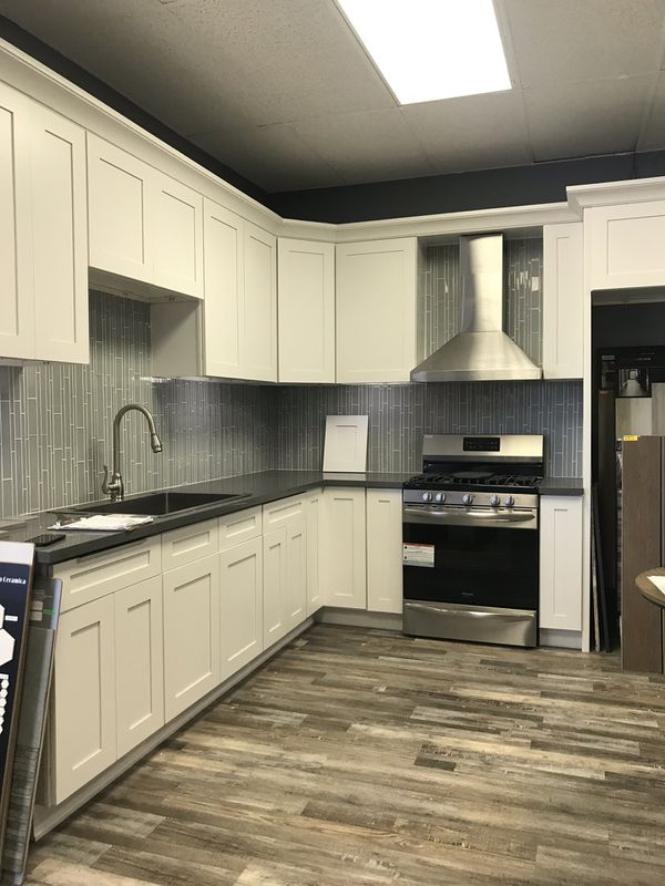 Cabinet - flooring - air conditioning- appliances