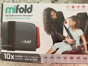 Mifold the grab and go booster seat new car seat for Sale in Trumbull, CT