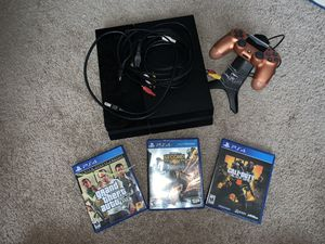 Standard ps4 with all the cables including three games and a controller w/ controller charger for Sale in Bellevue, WA